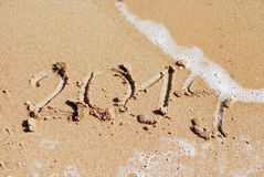 Sand Nr. 2014 auf Strand Stockfoto