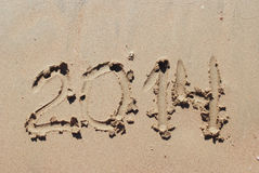 Sand number 2014 on beach Stock Images