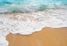 Sand and ocean wave Stock Photo