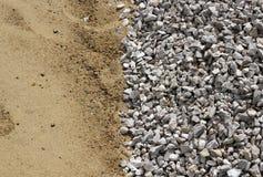 Sand och bruten stenlodlinjebakgrund Arkivbilder