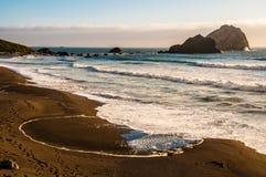 Sand och hav Arkivbild