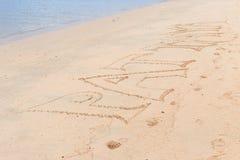 Sand och PATTAYA writed på sand Royaltyfri Foto