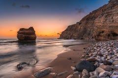 Sand och Pebble Beach på Cavo Paradiso i Kefalos, Kos ö, Grekland Arkivbild