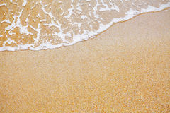 Sand och wavebakgrund Royaltyfri Foto