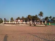 Sand på stranden i goa Arkivfoto