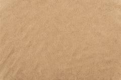 Sand på stranden som bakgrund arkivfoton