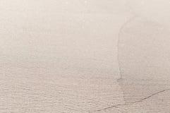 Sand på stranden som en bakgrund Arkivbilder