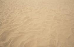 Sand på stranden, vågor av sand Royaltyfri Foto