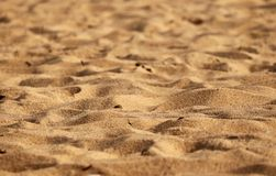 Sand p? strandferie turnerar destinationer arkivbilder