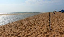 Sand p? strandferie turnerar destinationer arkivbild