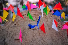 Sand pagoda decorated by colorful flags. In Songkran festival royalty free stock photos
