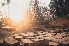 Sand pagoda Songkran festival Paper flag on the pile of sand Evening light In the countryside Chiang Mai. Thai Royalty Free Stock Image