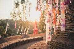 Sand pagoda Songkran festival Paper flag on the pile of sand Evening light In the countryside Chiang Mai. Thai Stock Images