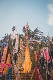 Sand pagoda Songkran festival Paper flag on the pile of sand Evening light In the countryside Chiang Mai. Thai Royalty Free Stock Photos
