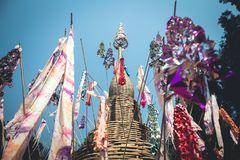 Sand pagoda Songkran festival Paper flag on the pile of sand Evening light In the countryside Chiang Mai. Thai Royalty Free Stock Photo