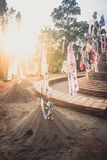 Sand pagoda Songkran festival Paper flag on the pile of sand Evening light In the countryside Chiang Mai. Thai Stock Image