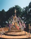 Sand pagoda Songkran festival Paper flag on the pile of sand Evening light In the countryside Chiang Mai. Thai Stock Photos