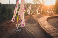 Sand pagoda Songkran festival Paper flag on the pile of sand Evening light In the countryside Chiang Mai. Thai Royalty Free Stock Photography
