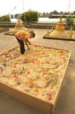 Sand Pagoda in Traditional Thai New Year, Songkran festival. BANGKOK,THAILAND- APRIL 12,2015 : Unidentified Thai boy come to build the Sand Pagoda for return stock photos