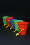 Sand Pails. Row of pails stock photography