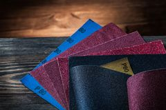 Sand paper assortment on vintage wood background stock image