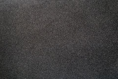 Sand paper texture. Black sand paper texture background Stock Photos