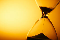 Sand passing through the bulbs of an hourglass Royalty Free Stock Photo
