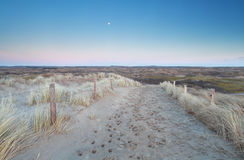 Sand path to dunes in dusk Royalty Free Stock Photography