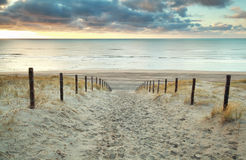 Sand path to the North sea at sunset Royalty Free Stock Photo