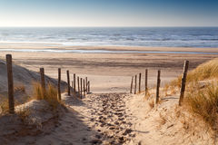 Sand path to North sea at sunset Stock Photo