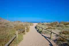 Sand path with wooden banisters to Genoveses Beach in Almeria stock images