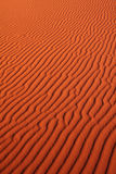 Sand pattern. Pattern of ripples in the sand around sunset hour (long shadows Royalty Free Stock Photos