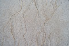 Sand pattern on the beach. Beautiful natural texture design left by the tide on the beach royalty free stock photo