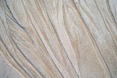 Sand pattern on the beach. Beautiful natural texture design left by the tide on the beach stock images