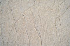 Sand pattern on the beach. Beautiful natural texture design left by the tide on the beach stock photo