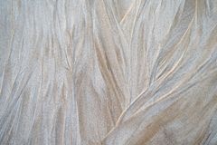 Sand pattern on the beach. Beautiful natural texture design left by the tide on the beach stock photos
