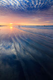 Sand pattern with dramatic sunset clouds Royalty Free Stock Photo