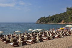 The sand and pebble beach of Mogren in Budva Stock Images
