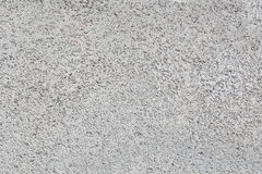 Sand and Pebbles on wall, background textures Royalty Free Stock Photography