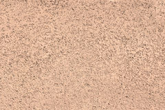 Sand and Pebbles on wall, background textures Royalty Free Stock Image