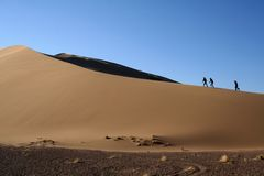Sand and People. People in beautiful desert. Asia Stock Image
