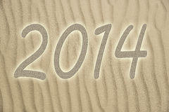 Sand with 2014. Picture of golden sand with small waves and letters 2014 Stock Images