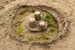 Sand pies made by children on a beach royalty free stock images