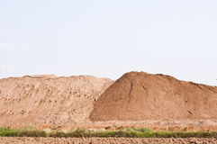 Sand pile. For sale with blue sky, Thailand Royalty Free Stock Images