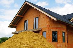 Sand pile before house Stock Image