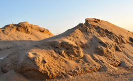 Sand piles_01. Small sand piles that look like sand dunes Royalty Free Stock Photos