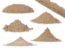 Sand piles isolated on white. Background royalty free stock images