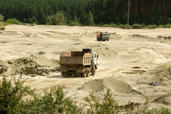 Sand-pit. Open cast mine pit/ One truck,full, goes up and another,empty, goes down Stock Photography