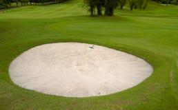 Sand Pit with Rake Stock Image