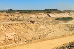 Sand pit on a sunny day. POLEWOJE, KALININGRAD REGION, RUSSIA — JUNE 18, 2014: Sand pit on a sunny day Stock Photography